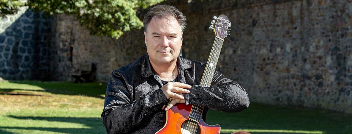 Erik portrait with guitar hohner